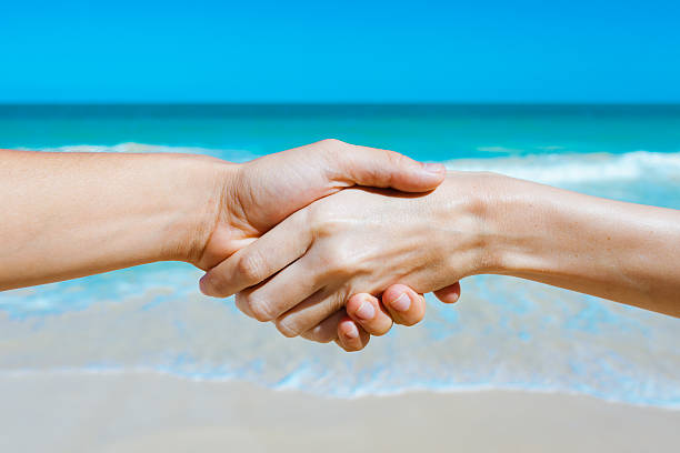 Handshake on the beach for get clients section Brand Kahuna St Charles Web Design